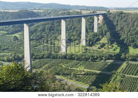 View On High Freeway Viaduct Bridge Across Mosel River Valley And Terraced Vineyards, Road Network A