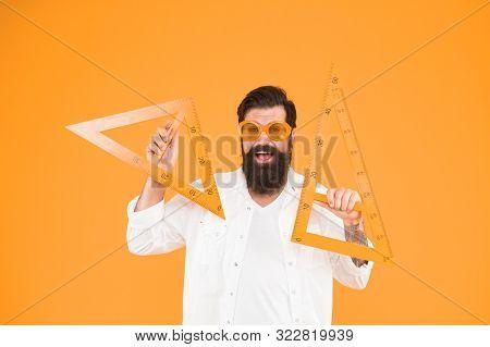 Nerd Succeeded In Proving The Theorem. Happy Nerd. Study Nerd Holding Triangles On Orange Background
