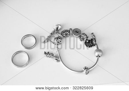 Silver Wedding Rings And Silver Bracelet. Bridal Silver Jewelry In Black And White With Noisy Effect