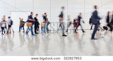 Many anonymous people walk to business trade fair