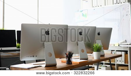 Minsk, Belarus - 88 September 2019: Many Apple Imac Computer Aganist Empty Office Background. Illust