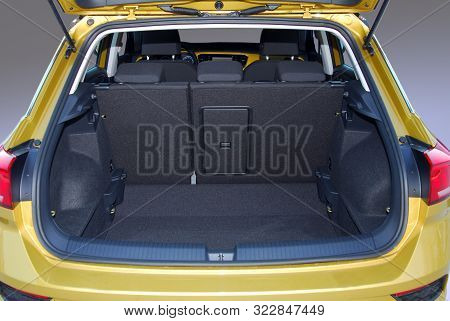 Empty Trunk Of The Small Yelow Suv