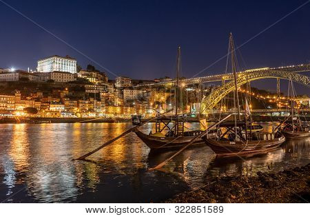 Porto, Portugal - 12 August 2019: Night View Of Rabelo Boats And Cityscape Of Porto From The Banks O