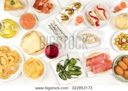 Spanish Tapas And Wine, An Overhead Photo Of A Variety Of Snacks. Gazpacho, Squid Rings, Tortilla, J