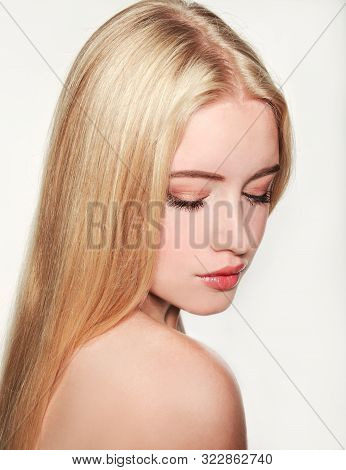 Portrait Of Beautiful Blonde Young Woman Face.  Spa Model Girl With Fresh Clean Skin Isolated On A W