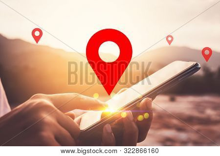 Woman Hand Using Smart Phone On Top Of Mountain With Navigator Location Point Abstract Background. T