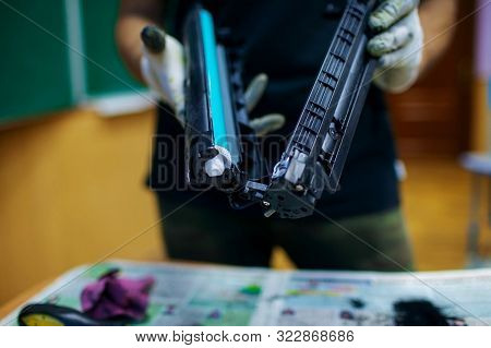 Technician Hand Cleaning Printer Toner Cartridge.  Used Laser Toner Cartridge.
