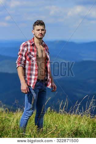 Cowboy In Hat Outdoor. Sexy Macho Man In Checkered Shirt. Countryside Concept. Farmer On Rancho. Man
