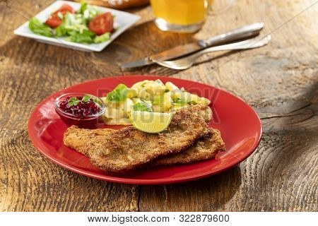 Wiener Schnitzel With Potato Salad On A Plate