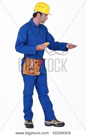 Electrician with an multi-meter