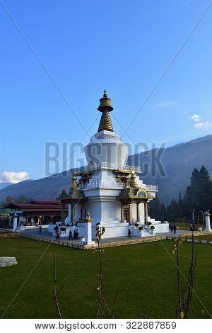 Thimphu, Bhutan- December 7, 2018: Buddhists Circling Clockwise The National Memorial Chorten While