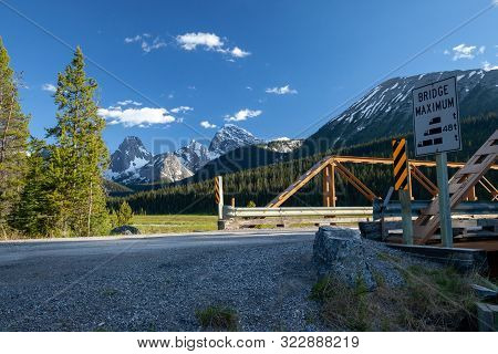 A Bridge On A Dirt Road In Kananaskis In The Canadian Rockies, Alberta, Canada