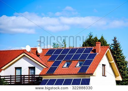 Solar Panels On The Roof Of A Building . Solar Cells For Solar Energy . Apartment House
