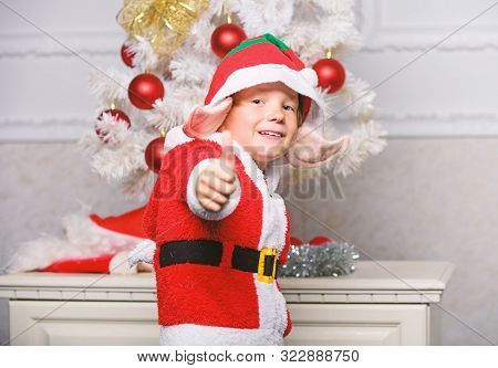 Christmas Tree Ideas For Kids. Boy Kid Dressed As Cute Elf Magical Creature White Artificial Ears An