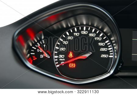 A Shot Of The Car Dashboard Glowing While Stationary