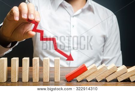 A Man Starts A Chain Reaction Of Falling Dominoes. Start Running Processes Or Sabotage And Subversio