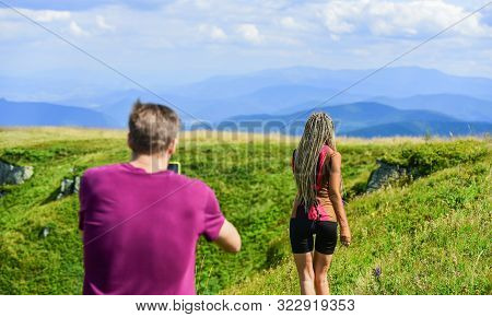 Young adventurers. Travel together with darling. Couple taking photo. Couple in love hiking mountains. Lets take photo. Capturing beauty. Man and woman posing mobile photo. Summer vacation concept poster