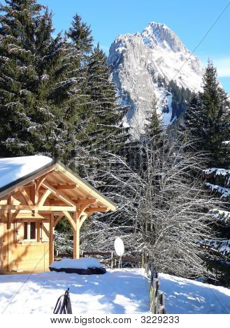 French Chalet With Mountains On The Background