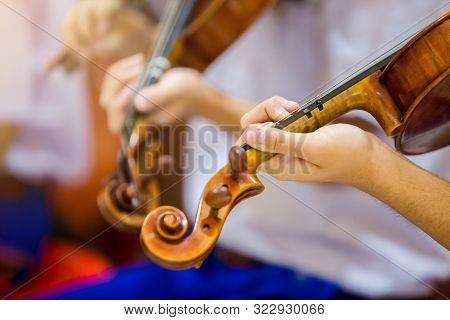 Asian Boy Students Playing Violin With Music Notation In The Group. Violin Player. Violinist Hands P