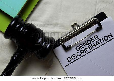 Gender Discrimination Document Form And Black Judges Gavel On Office Desk. Law Concept