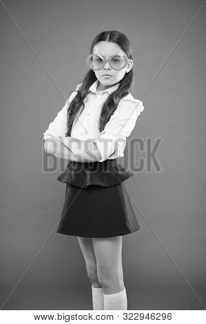Goggles Are More Than Just Eyeglasses. Adorable Little Girl Wearing Fancy Goggles On Orange Backgrou