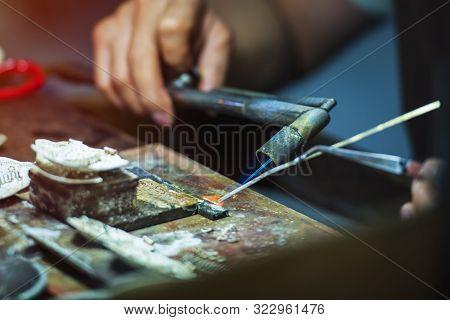 Silverware Making. Craftsman Are Making Silverware.the Original Of The Silver Craftsmen At Chiang Ma