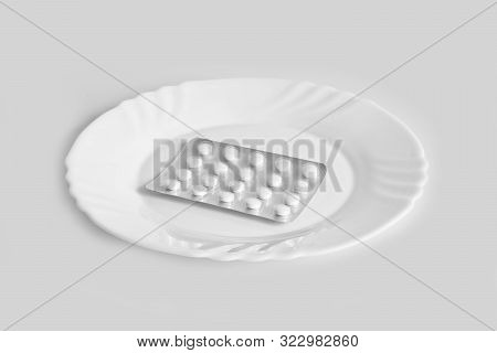 Different Pills On A Plate. The Concept Of Prescription Drugs For Weight Loss. Means For Suppressing