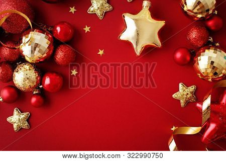 red and gold christmas ornaments. christmas frame background