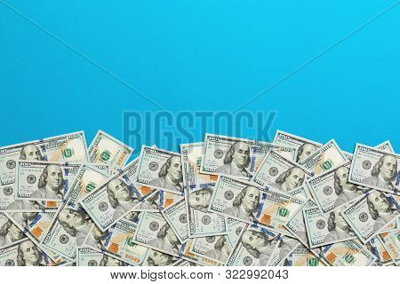 One Hundred Dollar Banknotes On Colored Background Top View, With Empty Place For Your Text Business