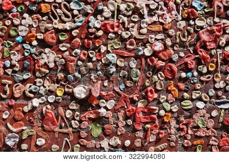 Gum Wall. Chewing Gums Stuck To The Wall. One Of The Tourist Attractions  In Post Alley In Downtown