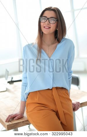 smiling young business woman standing in office