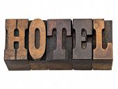 hotel - isolated words in vintage letterpress wood type, French Clarendon font popular in western movies and memorabilia poster