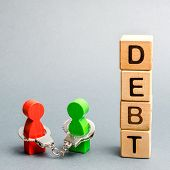 Two people are bound by handcuffs with the word Debt. Creditor and debtor. Financial slavery. Unclosed commitments. Blackmail and illegal pursuit. Psychological pressure. Debts relief. Debt pit. poster