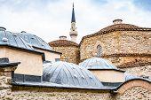 Building of turkish hammam with minaret in Prizren, Kosovo poster