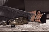 dead woman lying on the floor bottle of whisky and pills near her legs poster