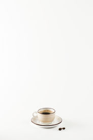 Light colored cup on the white background