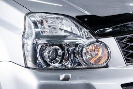 Novosibirsk, Russia - August 24, 2019:  Nissan X-trail, Car Headlights. Exterior Detail. Close Up De