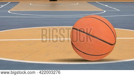 Composition of orange basketball over orange and blue basketball court. sport and competition concept digitally generated image.