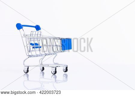 Shopping Trolley, Supermarket Trolley On A White Background. Copy Space.