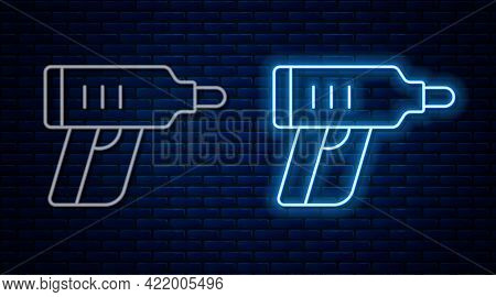 Glowing Neon Line Electric Cordless Screwdriver Icon Isolated On Brick Wall Background. Electric Dri