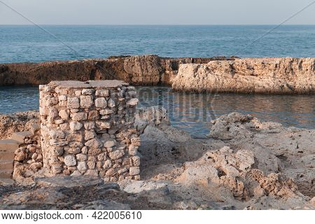 Coastal View With Ruined Stone Fortifications. Montazah Beach, Alexandria, Egypt