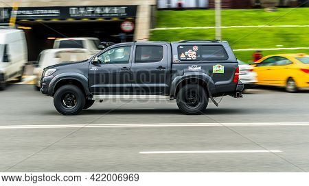 Moscow, Russia - May 2021: Toyota Hilux Motion Image, Car Running On The Road With Blurred Backgroun