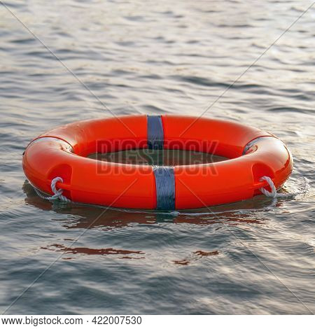 Red Lifebuoy In Sea On Water. Life Ring Floating On Top Of Water