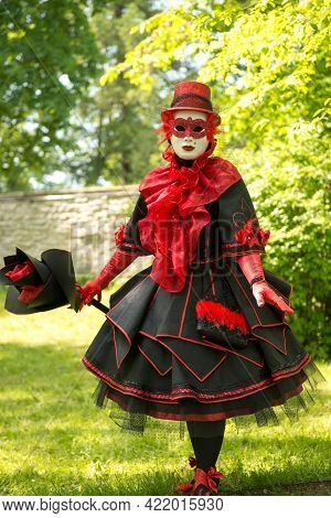 Traditionally Dressed Venice Carnival Person - Woman In Red Andblack Carnival Venetian Costume