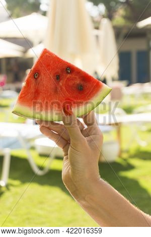 Young Woman Hand Holding And Enjoying Watermelon.
