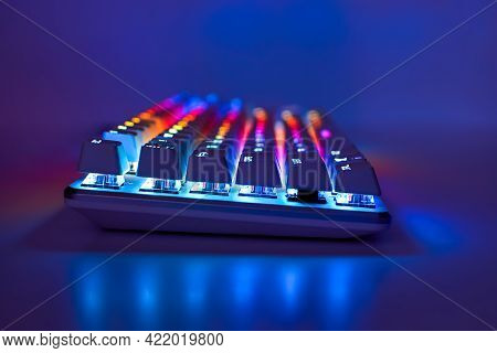 Backlit Keyboard. Gaming Keyboard With Rgb Light, Side View. Colorful Keyboard In Neon Light