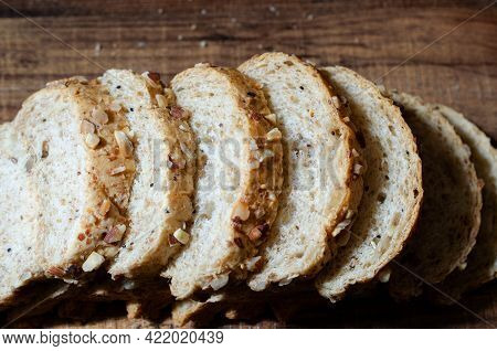 Group Of Sliced Wholewheat Bread On Wooden Background In Dark Tone Ready For Breakfast Meal