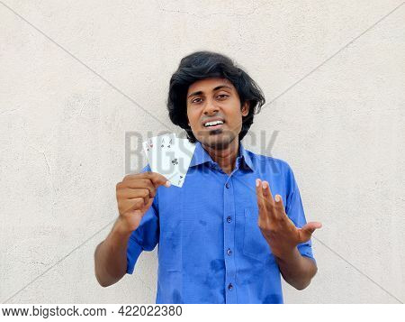 Young South Indian Man Holding Four Ace Poker Cards Looking Confident,cheerful,happy. White Backgrou