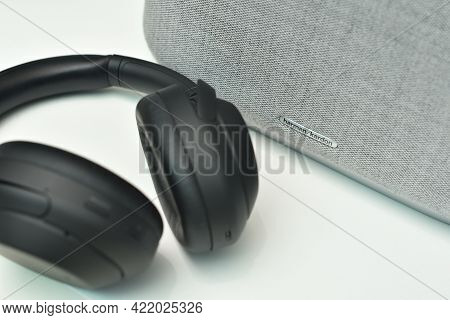 Stariy Oskol, Russia - May 19, 2021: Harman Kardon Logo On Bluetooth Speaker And Wireless Headphones