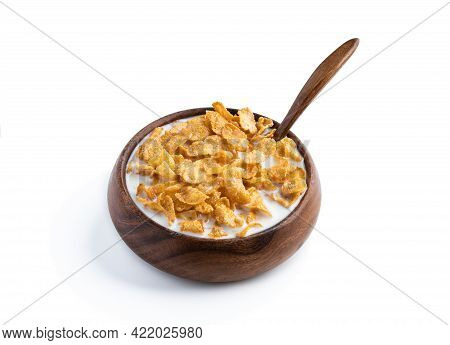 Corn  Flakes With Milk In Wooden Bowl Isolated On White Background